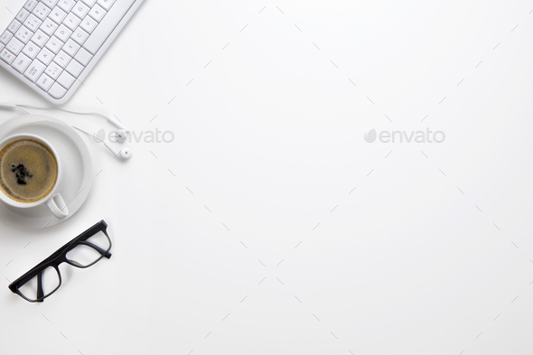 Keyboard With Eyeglasses, Coffee Cup And Earphones On White Desk - Stock Photo - Images