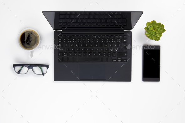 Contemporary white office desk with Laptop and Coffee Cup - Stock Photo - Images