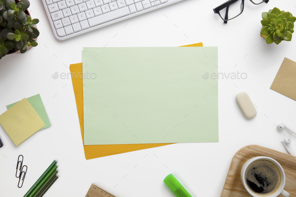 Blank Documents Surrounded With Office Supplies On White Desk - Stock Photo - Images