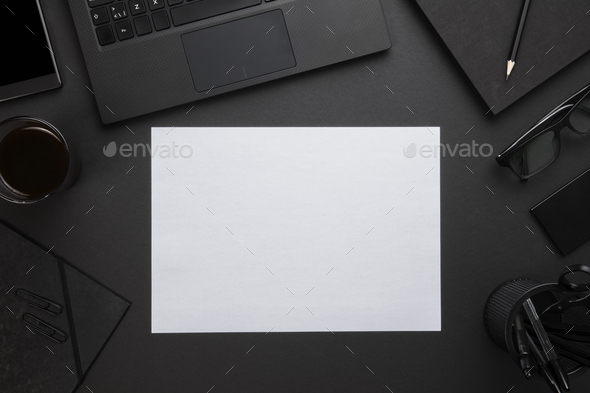 Blank Paper With Laptop And Office Supplies On Gray Desk - Stock Photo - Images