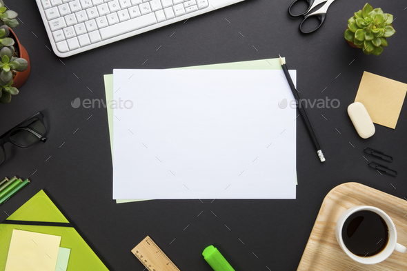 Blank Paper Surrounded By Office Equipment On Gray Desk - Stock Photo - Images