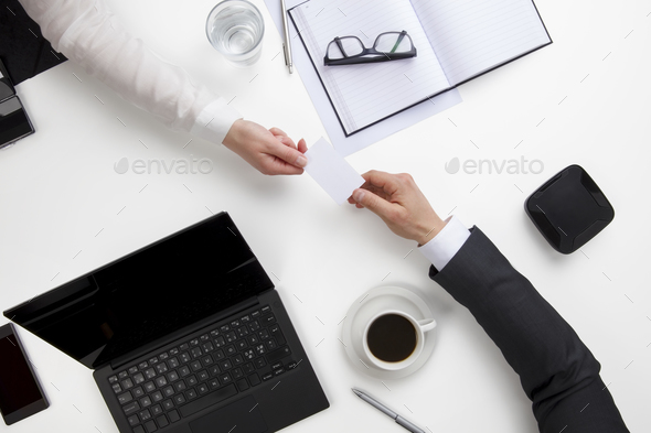 Business People Exchanging Visiting Card At Office Desk - Stock Photo - Images