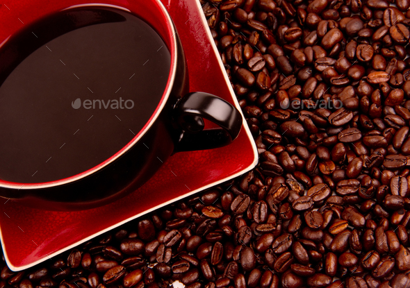 Java in Cup and Saucer Sitting in Coffee Beans - Stock Photo - Images
