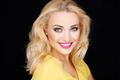 Smiling beautiful blond woman wearing makeup