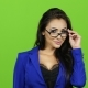 Sexy Brunette Woman with Glasses Posing on Camera, Green Screen