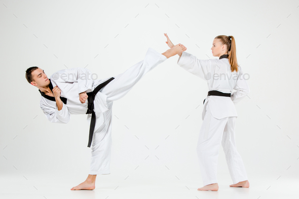 The karate girl and boy with black belts - Stock Photo - Images