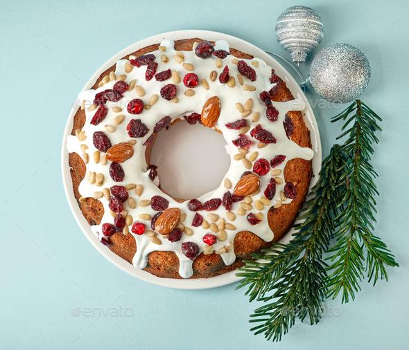 Christmas cake on blue background - Stock Photo - Images