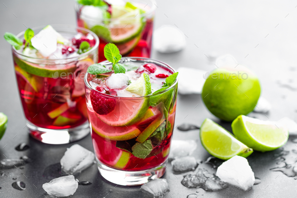 Raspberry mojito cocktail with lime, mint and ice, cold, iced refreshing drink or beverage - Stock Photo - Images