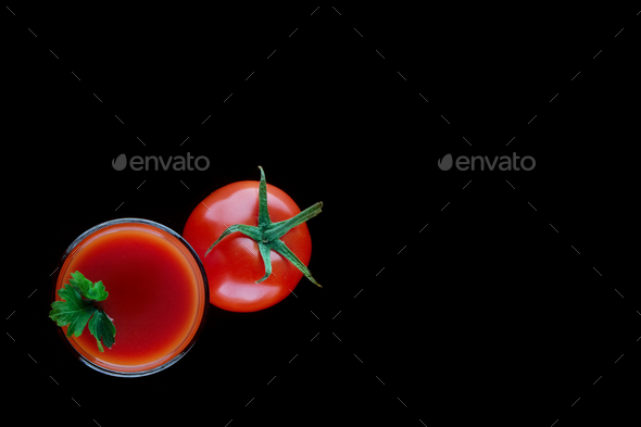 Glass of tomato juice with parsley and a tomato - Stock Photo - Images