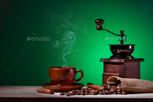 Coffee with steam coffee grinder and coffee beans - Stock Photo - Images