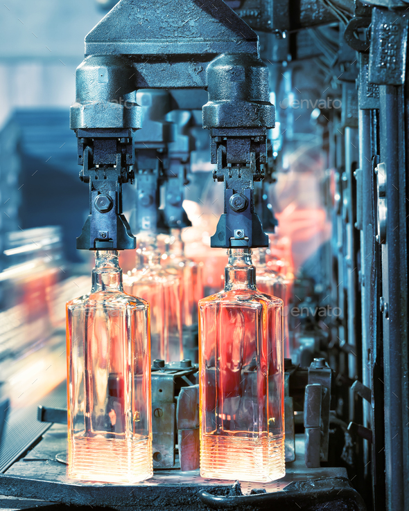 The machine for the production of glass bottles in the productio - Stock Photo - Images