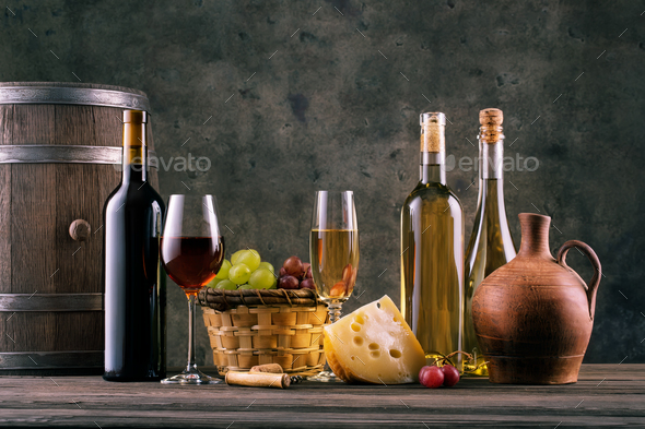 Wine still life with glasses of bottles and grapes - Stock Photo - Images