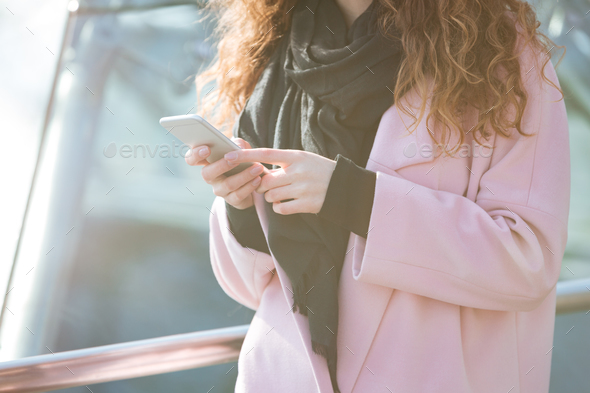 Close-up shot of woman using cellphone in the street. - Stock Photo - Images