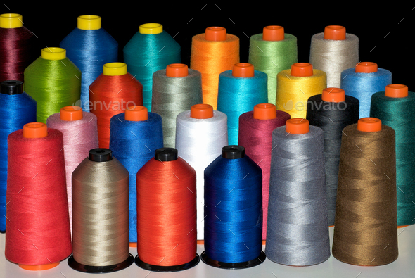 Colour spools in many rainbow colours - Stock Photo - Images