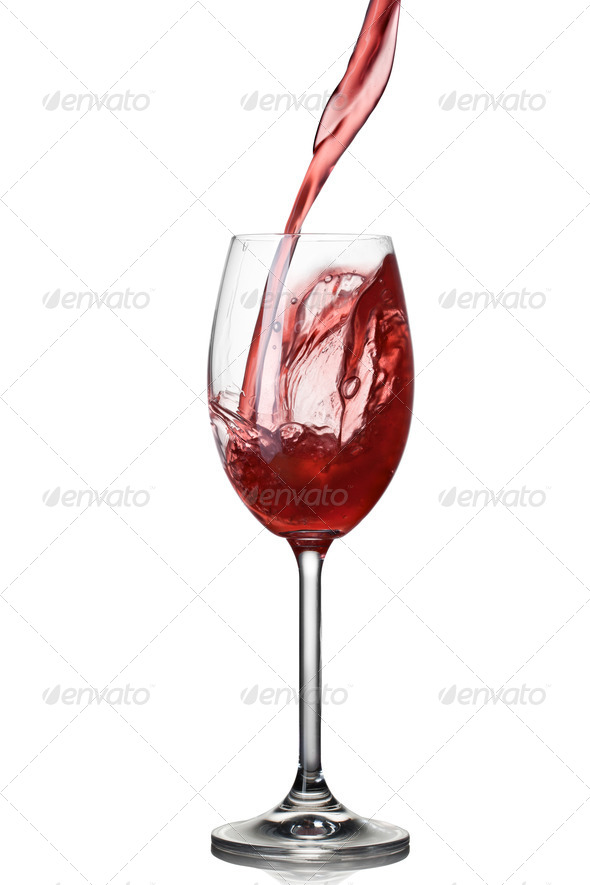 Splash of wine in glass isolated on white - Stock Photo - Images