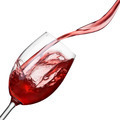 Splash of wine in glass isolated on white - PhotoDune Item for Sale