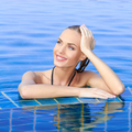 Smiling Woman Reflected In Pool - PhotoDune Item for Sale