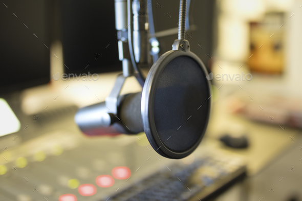 Close-up of a microphone in radio station broadcasting studio - Stock Photo - Images