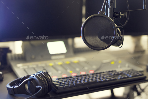 Microphone and headset in radio station broadcasting studio - Stock Photo - Images