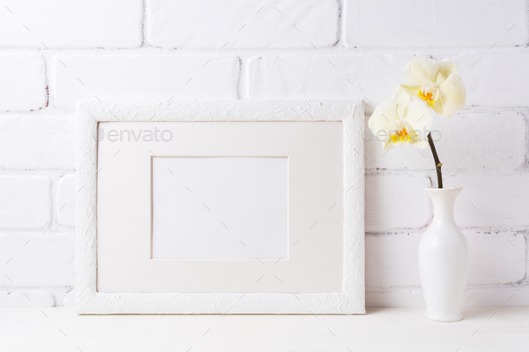 White frame mockup with soft yellow orchid in vase - Stock Photo - Images