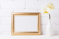 Golden  landscape frame mockup with soft yellow orchid in vase - PhotoDune Item for Sale
