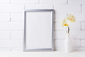 Silver frame mockup with soft yellow orchid in vase - PhotoDune Item for Sale
