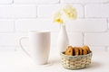 White coffee cappuccino mug mockup with soft yellow orchid in va - PhotoDune Item for Sale
