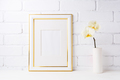 Gold decorated frame mockup with soft yellow orchid in vase - PhotoDune Item for Sale