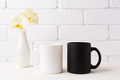 White and black mug mockup with soft yellow orchid in vase - PhotoDune Item for Sale