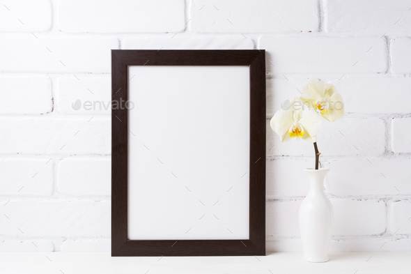 Black brown  frame mockup with soft yellow orchid in vase - Stock Photo - Images