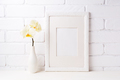 White frame mockup with soft yellow orchid in vase - PhotoDune Item for Sale