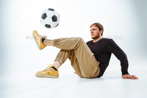 A portrait of a fan with ball on gray studio background. Freestile - Stock Photo - Images