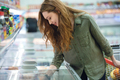 Woman bying products in mall - PhotoDune Item for Sale