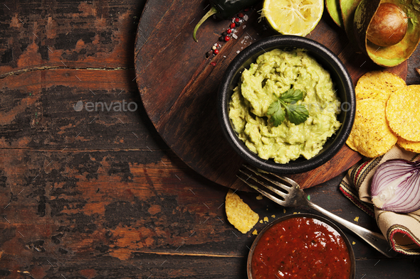 Mexican nachos chips with homemade fresh guacomole sauce and sal - Stock Photo - Images