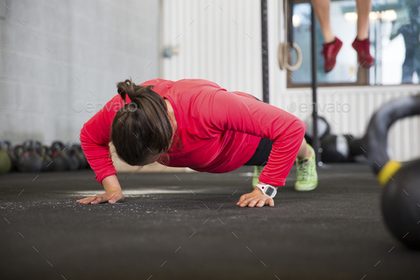 Fit Female Athlete Doing Pushups In Health Club - Stock Photo - Images