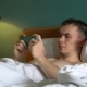 Man Is Lying in Bed and Is Using His Smartphone - VideoHive Item for Sale