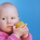 Baby Eats Peeled Plum Holding It in Both Hands - VideoHive Item for Sale