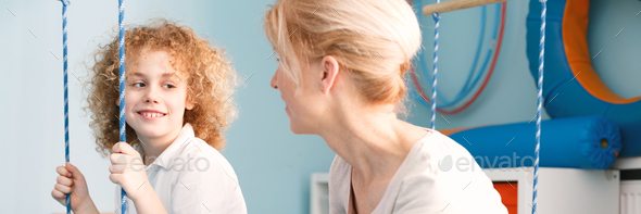Boy talking to physiotherapist - Stock Photo - Images