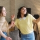 Three Young Active Girlfriends Dance Disco and Hop Together, While Having Fun at Home