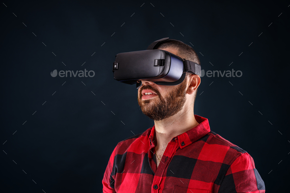 Man wearing virtual reality glasses - Stock Photo - Images