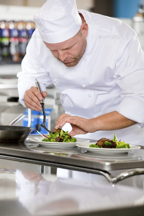 Professional chef prepare steak dish at restaurant - Stock Photo - Images