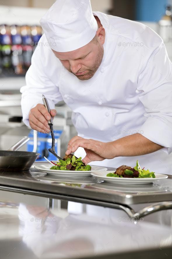 Professional chef prepare steak dish at restaurant - Stock Photo - Images