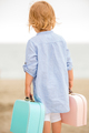 Cute little girl with her suitcase at the sea - PhotoDune Item for Sale