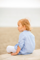 Pretty blond girl sitting overlooking the sea - PhotoDune Item for Sale