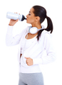 Sporty woman drinks from fitness bottle - PhotoDune Item for Sale