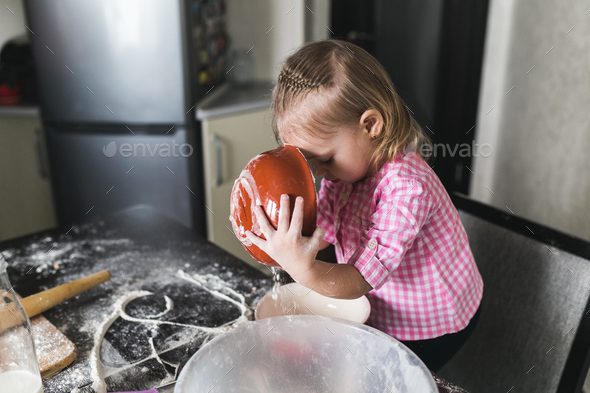 Little girl in the kitchen - Stock Photo - Images
