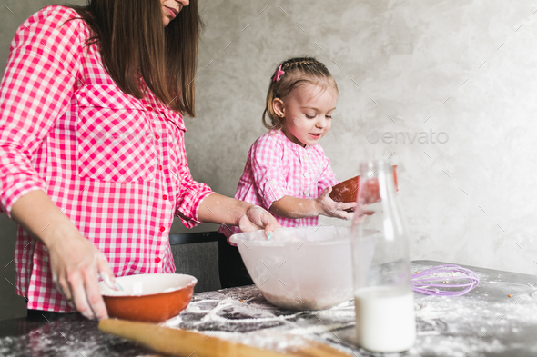 Mom and daughter together in the kitchen - Stock Photo - Images