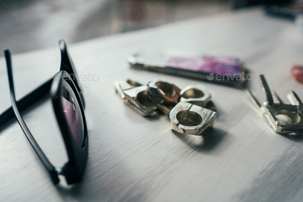 sunglasses and rings on a table - Stock Photo - Images