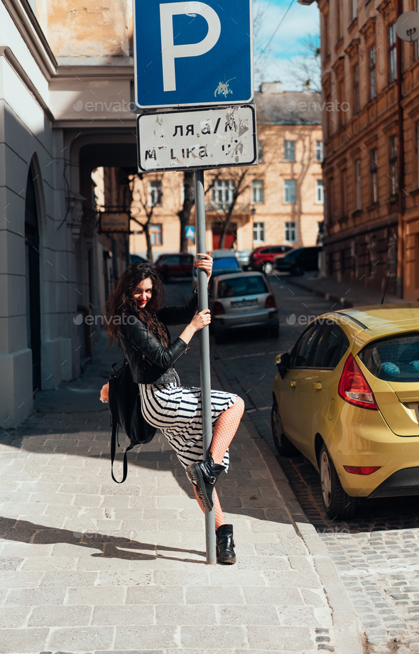 Beautiful fashionable lady posing on old street - Stock Photo - Images