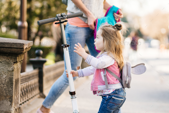 Little girl and scooter - Stock Photo - Images